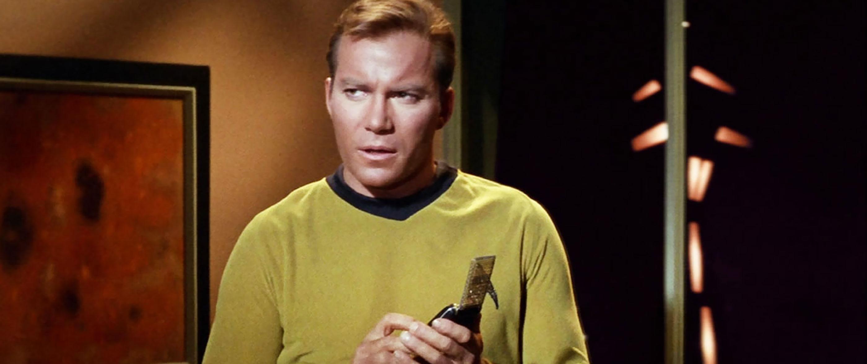 Captain Kirk Using a Communicator